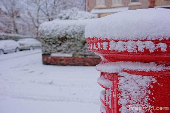 Red British Royal Mail Postbox in Winter